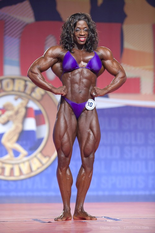 Iris Kyle is a competitive bodybuilder and has won Ms. Olympia an incredible 10 times. She competes in a sport that is not regulated by international doping standards and as such no doubt a user of anabolic steroids, growth hormones and other performance enhancing drugs. Kyle is an example of how a woman can become bulky…she does drugs! She injects, consumes and uses substances that bring her body more into alignment with the hormonal makeup of a very gifted male - and as such is able to gain and maintain insane levels of muscle growth.